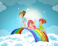 Fairies flying over the rainbow Royalty Free Stock Image