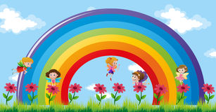 Fairies flying over the rainbow Royalty Free Stock Photo