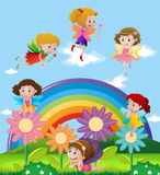 Fairies flying over the rainbow Royalty Free Stock Images
