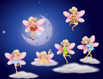 Fairies flying in the sky at night. Illustration Stock Photo