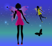 Fairies silhouete and stars. Fairies and butterfly on the stars Stock Photo