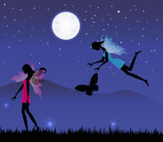 Fairies under the moonlight Royalty Free Stock Photo