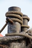 Fairleads with ropes,Ropes at a commercial ship in port Royalty Free Stock Photos