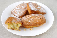 Fairly tasty muffins in a plate. Fairly tasty muffins in a white plate and the natural fibre background Stock Photo