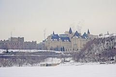 Fairmont Château Laurier castle and Connaught building, seen fromacross the frozen Ottawa river. Fairmont Château Laurier castle, seen fromacross the royalty free stock images