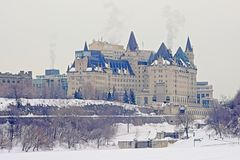 Fairmont Château Laurier castle, seen from across the frozen Ottawa river. On a cold gray winter day. Ottawa, Ontario, Canada stock photo
