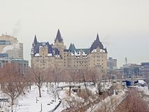 Fairmont Château Laurier castle on a cold winter day, Ottawa. Fairmont Château Laurier castle, seen from Maroor`s hill park r on a cold gray winter day stock photography