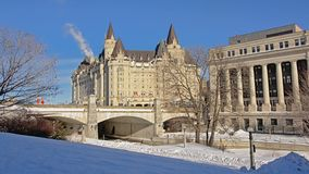 Fairmont Château Laurier castle on a winter day with snow in Ottawa, capital of Canada. Fairmont Château Laurier castle along rideau canal on a sunny stock photo