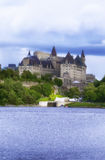 Fairmont Chateau Laurier. Cloudy summer day. Ottawa river in front Royalty Free Stock Image