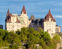 Fairmont Chateau Laurier in Ottawa - Ontario, Canada. It i is a grand hotel in downtown designed in the French Gothic Castle style adjacent to Parliament stock photo
