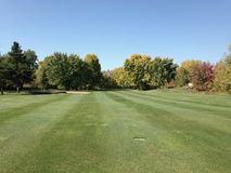 Fairway in the autumn, on a golf course. Fairway of a nice golf club in Quebec, in septembre.  Lot of maple trees around the green Stock Photos