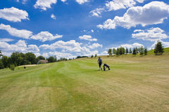 Fairway of a beautiful golf course. With golfer under dramatic summer sky Stock Photography