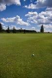 Fairway of a beautiful golf course. Golf ball on a fairway of a beautiful golf course with dramatic summer sky Stock Images