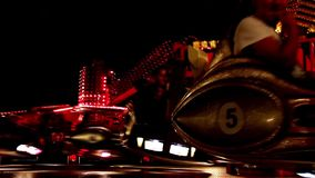 Fairway festival. Carousels in amusement park at night stock footage