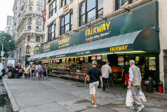 Fairway market. New York, August 3, 2017: People walk by Fairway supermarket on Broadway stock photography