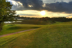 Fairway sunset. Golf course fairway at sunset royalty free stock photography