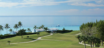 A fairway on a tropical golf course, with a view of the ocean Royalty Free Stock Photos