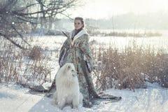 Fairy девушка с белой собакой Стоковое фото RF
