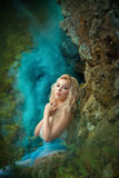 Fairy девушка на утесе Стоковая Фотография
