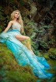 Fairy девушка на утесе Стоковые Изображения