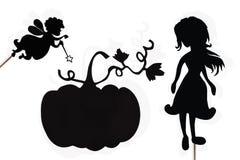 Fairy кума, Золушка и тыква затеняют марионеток на белизне Стоковое Изображение