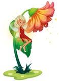 Fairy плавать около гигантского цветка Стоковые Изображения