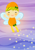 Fairy on abstract background. Cute orange firefly fairy with her magic wand flaying on abstract background leaving a stray of magic shiny stars Stock Photo