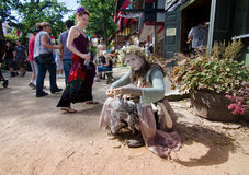 Fairy. An actor in a fairy costume and make up entertains passers-by at the Bristol Renaissance Faire in Wisconsin Royalty Free Stock Photography