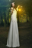 Fairy beautiful woman in magical forest Royalty Free Stock Photo