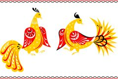 Fairy birds in the Gorodets painting style. Two yellow and red fairy birds with big tails, in front of each other, with borders, all made in the Gorodets style Royalty Free Stock Photos