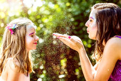 Fairy blowing magic powders to girl. Royalty Free Stock Photos