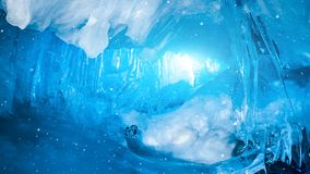 Fairy blue ice cave full of Icicles in Antarctica