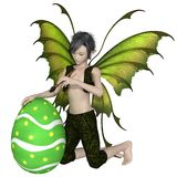 Fairy Boy Painting an Easter Egg Royalty Free Stock Photos