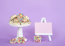Fairy Bread on pedestal with pink chalk board purple background Stock Photos