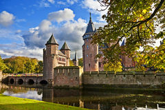 Fairy castle. Beautiful castle on water - Da Haar, Holland Stock Image
