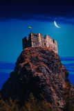 Fairy castle. On high mountains top at night Royalty Free Stock Images