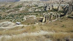 Fairy chimney in Cappadocia. Strange and amazing stone formations in Cappadocia Turkey Royalty Free Stock Photo
