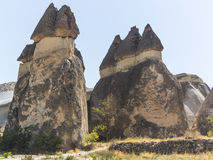 Fairy chimney houses. In ancient times people carved out homes in the fairy chimney rock formations in Cappadocia, Turkey. The houses are a popular tourist Royalty Free Stock Image