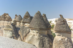 Fairy chimney houses. In ancient times people carved out homes in the fairy chimney rock formations in Cappadocia, Turkey. The houses are a popular tourist Royalty Free Stock Photography