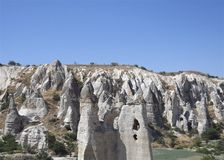 Rock formation,  geologic stones with blue sky. Fairy Chimneys rock formation, in Cappadocia, in Central Anatolia Stock Photo