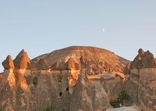 Fairy Chimneys of Cappadocia and The Moon. On blue Sky Stock Photo
