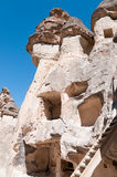 Fairy Chimneys of Cappadocia, Turkey. Close-up of mushroom-shaped fairy chimneys in Zelve Valley Open Air Museum, Cappadocia, Turkey.  Carved-out rooms in the Royalty Free Stock Image