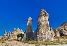 Fairy chimneys at Cappadocia Turkey. Fairy chimneys (rock formations) at Cappadocia Turkey - nature background royalty free stock photos