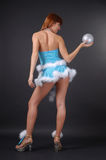 Fairy with christmas ball, rear view Stock Photography