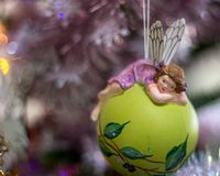 Fairy christmas ball suspended from the fir tree royalty free stock photography