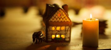 Fairy Christmas house cake with candle Royalty Free Stock Images