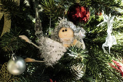 A fairy on the Christmas tree. A fairy ornament hanging on a branch of the Christmas tree Stock Photo
