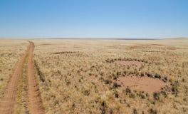 Fairy circles next to dirt road, a famous natural phenomenon, Damaraland, Namibia Southern Africa royalty free stock photo
