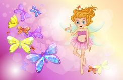 A fairy with the colorful butterflies Stock Image
