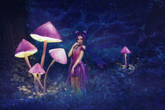 Fairy Coquette standing near the huge mushroom royalty free stock image